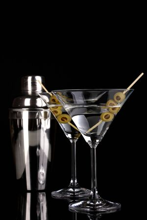 Martini glass with olives and shaker isolated on black Stock Photo - 16937965
