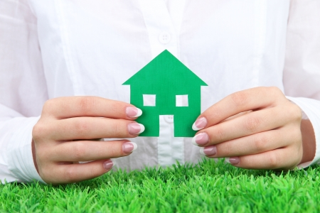 concept: woman hands with paper house, close up Stock Photo - 16938730