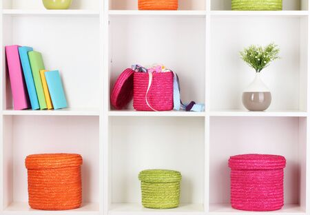 Color wicker boxes on cabinet shelves Stock Photo - 16938709