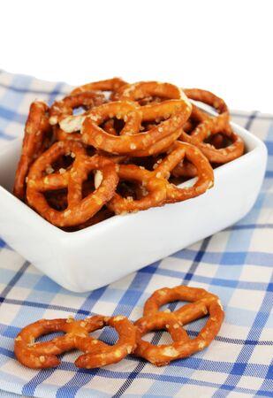 Tasty pretzels in white bowl isolated on white Stock Photo - 16938699