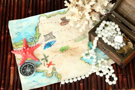 map of treasures on dark wooden background Stock Photo - 16938881