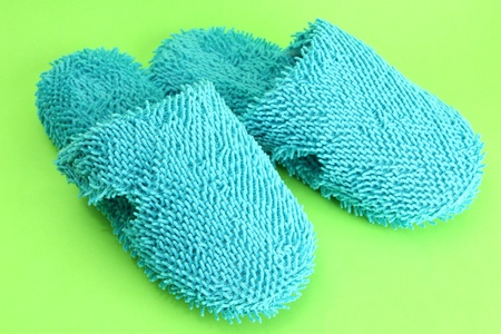 bright slippers, on green background Stock Photo - 16938911
