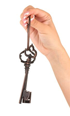 Womans hand with keys, on white background close-up photo