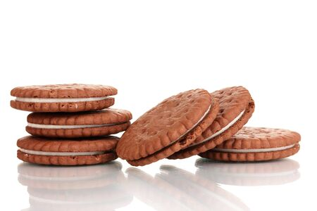 nutritiously: Chocolate cookies with creamy layer isolated on white