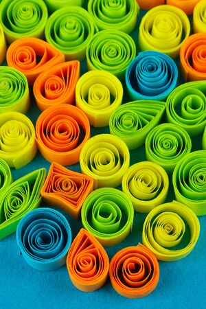 quilling: Colorful quilling on blue background close-up Stock Photo