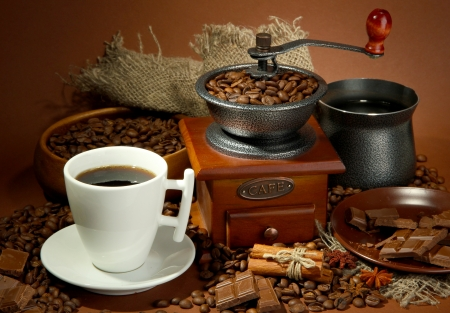 cup of coffee, grinder, turk and coffee beans on brown background Stock Photo - 16980141