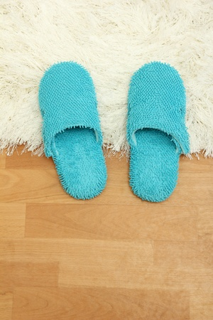bright slippers, on floor background photo