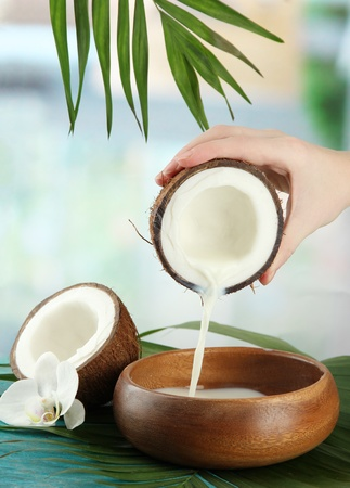 Coconut with leaves and flower, on blue wooden background Stock Photo - 16980199