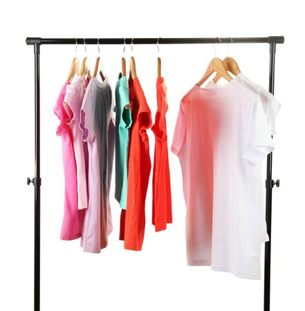 Choice of clothes of different colors on wooden hangers, isolated on white Stock Photo - 16980012