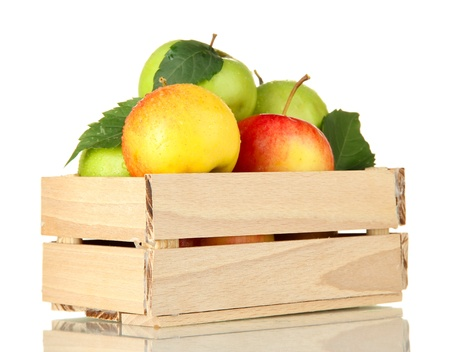 sweet apples in wooden crate, isolated on white photo