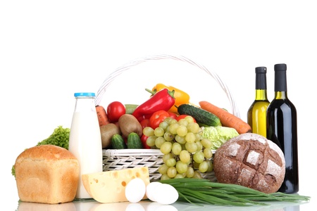 grocery basket: Composition with vegetables and fruits in wicker basket isolated on white