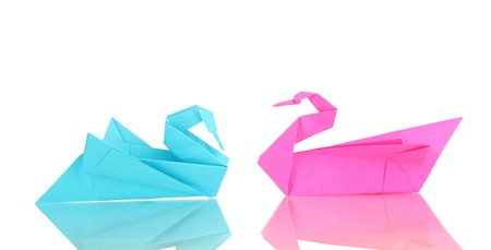 Origami swans isolated on white photo