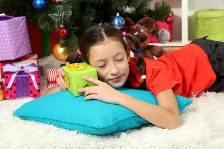 Little girl sleeping near christmas tree Stock Photo - 17186470