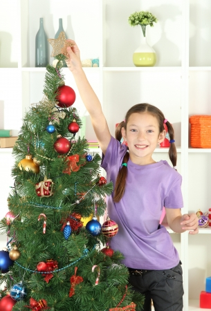 Little girl decorating christmas tree Stock Photo - 17186571