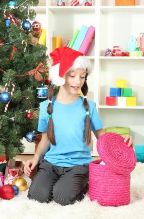 Little girl  with present box near christmas tree Stock Photo - 17129510