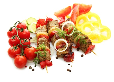tasty grilled meat and vegetables on skewers, isolated on white Stock Photo - 17000062