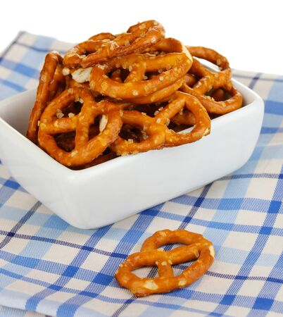 Tasty pretzels in white bowl isolated on white Stock Photo - 17000440