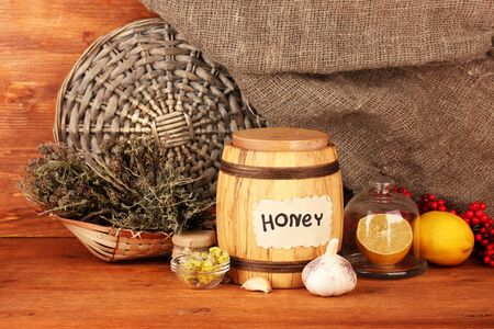 Honey and others natural medicine for winter flue, on wooden background photo