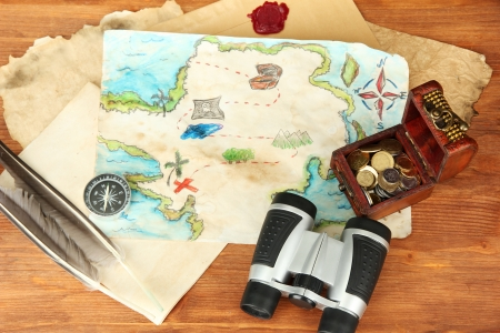 map of treasures on wooden background Stock Photo - 17000921