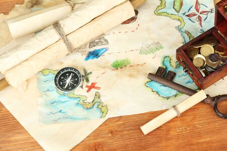 map of treasures on wooden background Stock Photo - 17000905