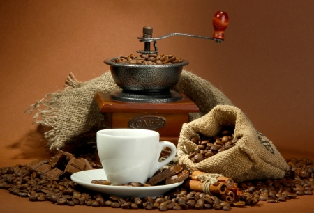cup of coffee, grinder, turk and coffee beans on brown background Stock Photo - 17000443