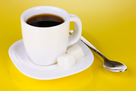 A cup of strong coffee on yellow background Stock Photo - 17000129
