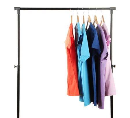Choice of clothes of different colors on wooden hangers, isolated on white Stock Photo - 16999252