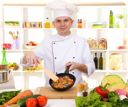 Chef cooking in kitchen Stock Photo - 17185422
