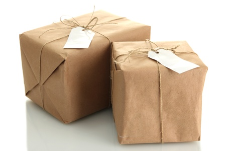 parcels boxes with kraft paper, isolated on white photo