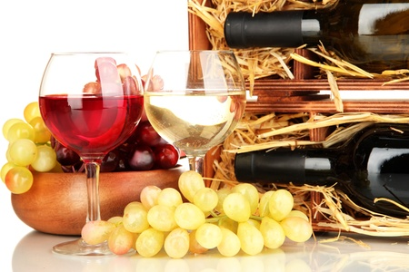 Wooden case with wine bottle, wineglasses and grape isolated on white photo