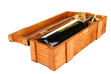 dura: Wooden case with wine bottle isolated on white Stock Photo