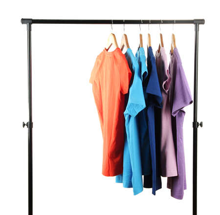 Choice of clothes of different colors on wooden hangers, isolated on white photo