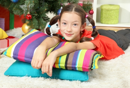 Little girl dreaming near christmas tree Stock Photo - 17129518