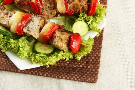 tasty grilled meat and vegetables on skewer on plate, on table Stock Photo - 17021054