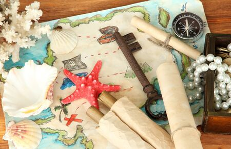 map of treasures on wooden background Stock Photo - 17129522