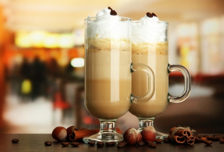 fragrant: Fragrant coffee latte in glasses cups with spices, on table in cafe Stock Photo