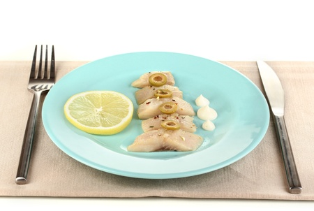 Dish of herring and lemon on plate isolated on white Stock Photo - 17020839