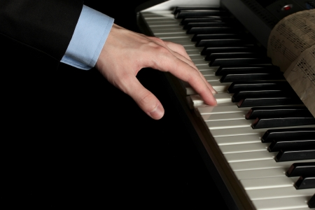 man hand playing piano photo