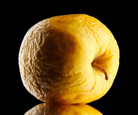 scarring: Yellow apple as problem skin concept, on black background Stock Photo