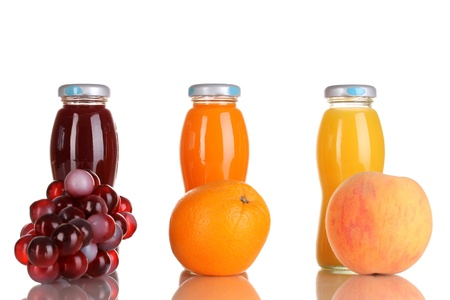 Delicious grapes, orange and apple juice in glass bottle and fruit next to it isolated on white Stock Photo - 17046388