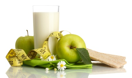 Glass of kefir, green apples, crispbreads and measuring tape isolated on white Stock Photo - 17046538