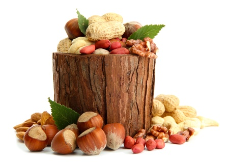 assortment of tasty nuts with leaves in wooden vase, isolated on white Stock Photo - 17047226