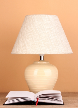 table lamp and notebook on beige background Stock Photo - 17048104
