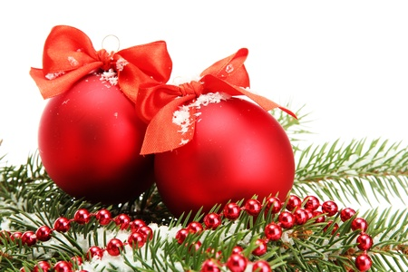 Christmas balls on fir tree with snow, isolated on white photo