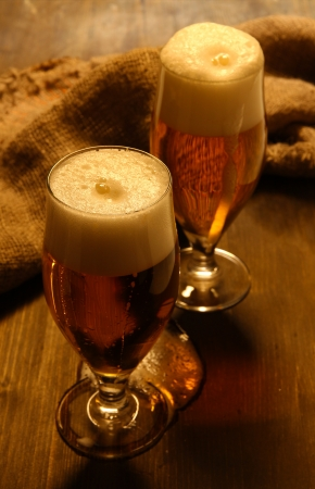 Glasses of beer on wooden table close-up Stock Photo - 17047470