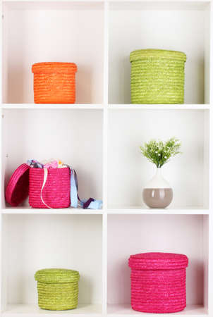 Color wicker boxes on cabinet shelves Stock Photo - 17047274