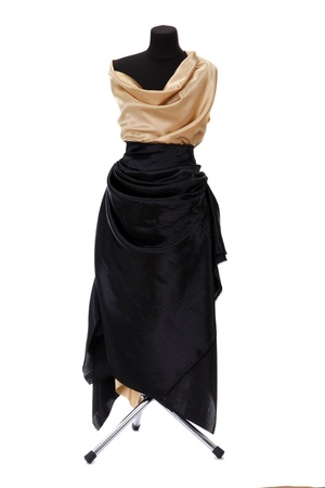 black mannequin with silk cloth isolated on white photo