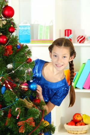 Little girl decorating christmas tree Stock Photo - 17186450