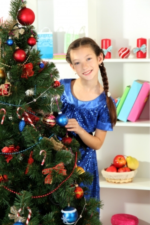 Little girl decorating christmas tree Stock Photo - 17186447