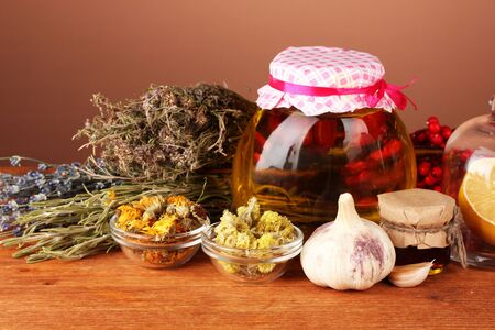 flue: Honey and others natural medicine for winter flue, on wooden table on brown background